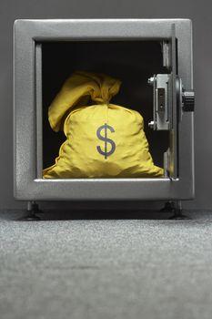 Sack with dollar symbol in safe