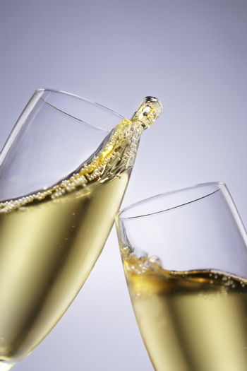Two champagne glasses toasting close-up