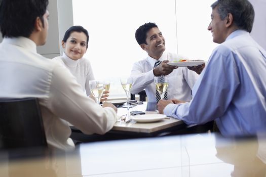 Business man taking meal from waiter during business meeting