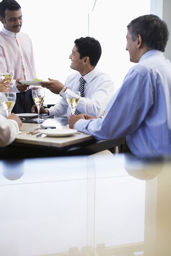 Business man taking meal from waiter