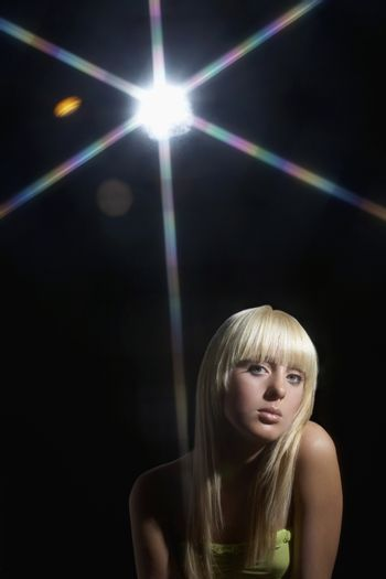 Young woman standing in disco