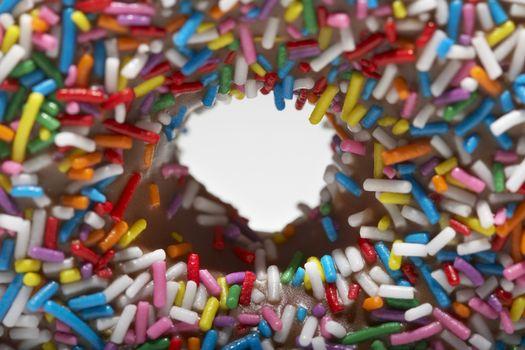 Rainbow sprinkles on doughnut close-up