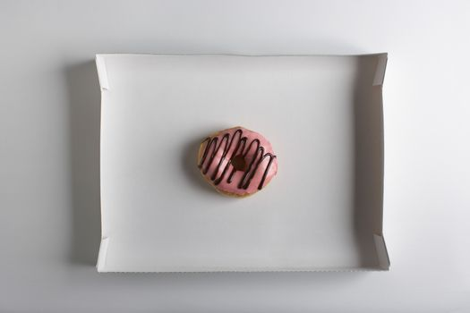 Single doughnut in cardbard box