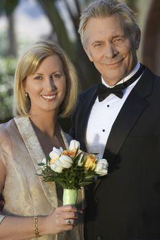 Portrait of beautiful couple in formal wear