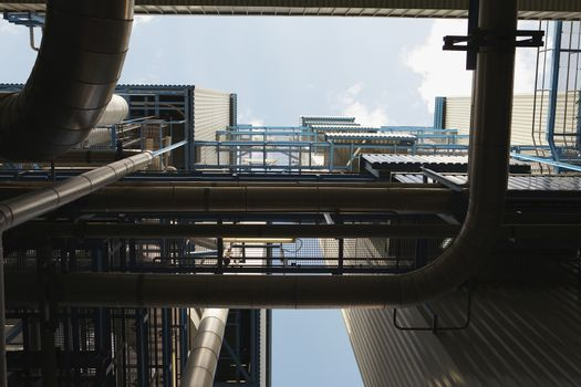 Low angle view of boiler complex of oil fired power station