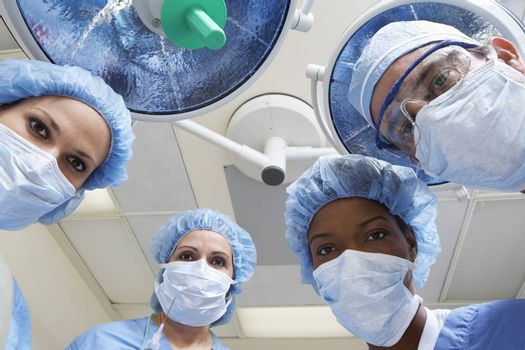 Four surgeons looking down low angle view