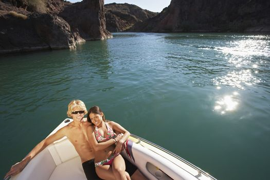 High angle view of happy young couple boating on lake