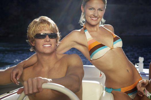 Portrait of happy Caucasian couple on boat ride