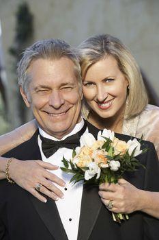 Portrait of happy Caucasian couple in formal wear