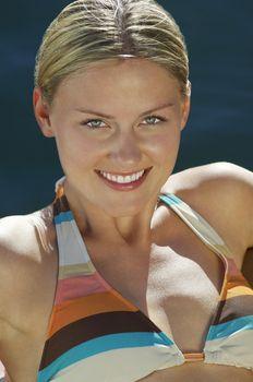 Portrait of a beautiful Caucasian woman wearing bikini
