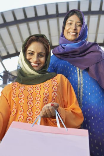 Portrait of Muslim women with shopping bag