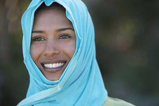 Portrait of muslim woman in blue headscarf smiling