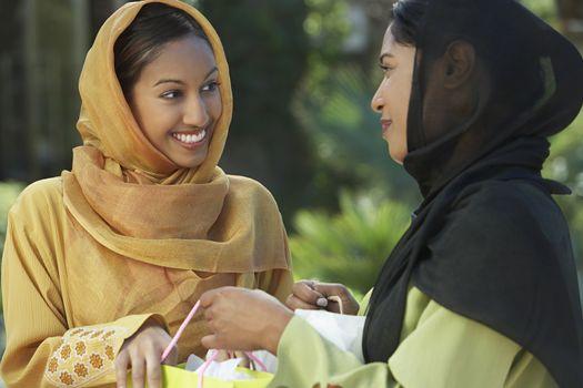 Two young muslim women talking outdoors