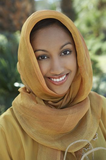 Portrait of a happy Muslim woman in traditional clothing