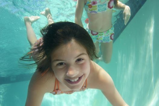 Portrait of a preadolescent girl swimming underwater