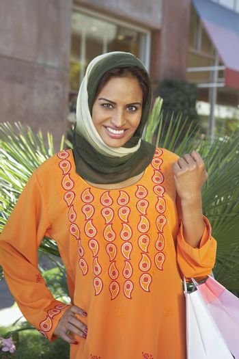 Portrait of Indian Muslim woman with shopping bag