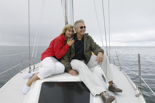Happy Caucasian couple on yacht