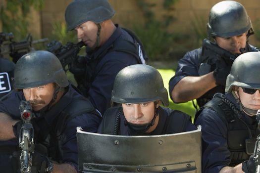 Swat officers behind shield