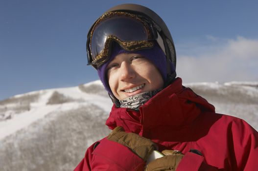 Portrait of young male snowboarder smiling