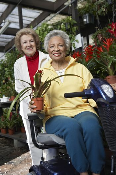 Portrait of two senior women at botanical garden