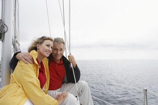 Happy Caucasian couple on sailboat