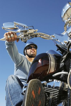 Closeup of biker on bike against clear sky
