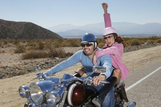 Multiethnic couple having fun on bike ride