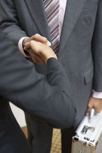 Detail of two business executives setting a deal