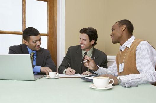 Happy multiethnic businessmen in meeting