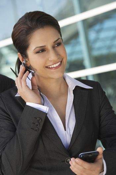 Beautiful businesswoman listening call