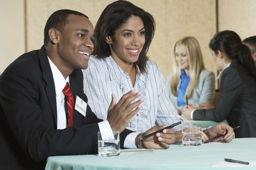 Business man and woman at conference meeting