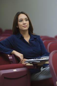 Attentive female executive at a business seminar