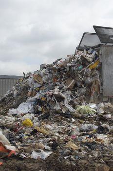 Truck discarding garbage at dumping ground
