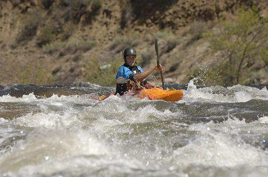 Caucasian man kayaking in river