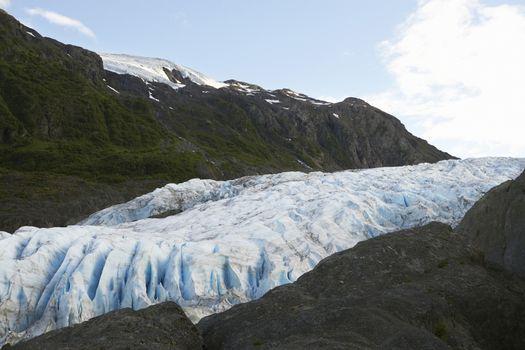 Glacier between rock cliffs, Alaska, USA