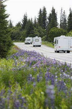 Recreational vehicles on a rural road, Alaska, USA