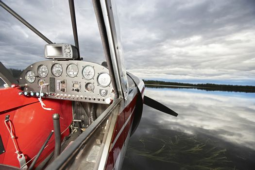Closeup of seaplane cockpit with cloudy sky in background, Alaska, USA