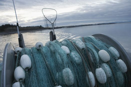 Commercial fishing net on back of a fishing boat at dusk