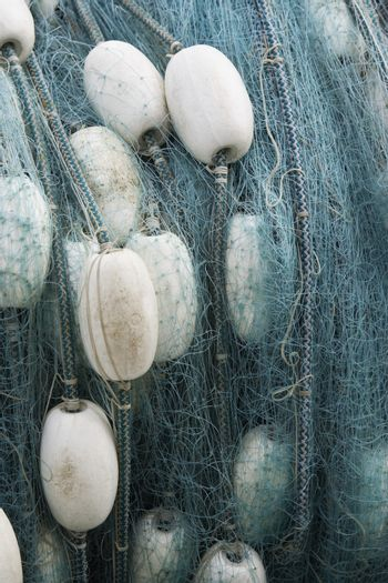 Closeup of a rolled up commercial fishing net with floats