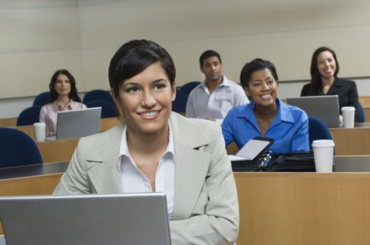 Business people sitting in classroom