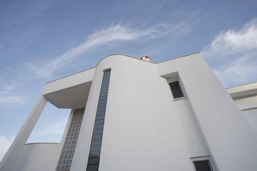 Low angle view of white residential building against sky