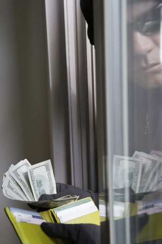 Burglar stealing money from wallet