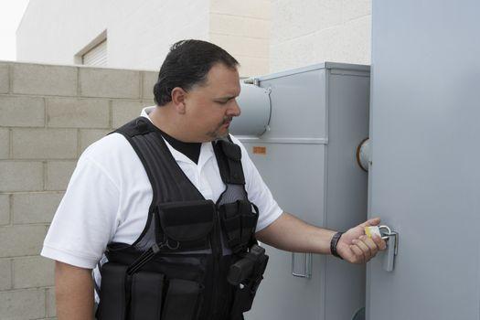 Security guard checking the padlock