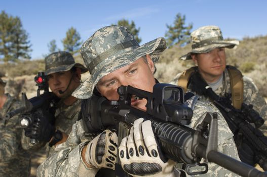 US army soldiers armed with machine guns and ready to shoot