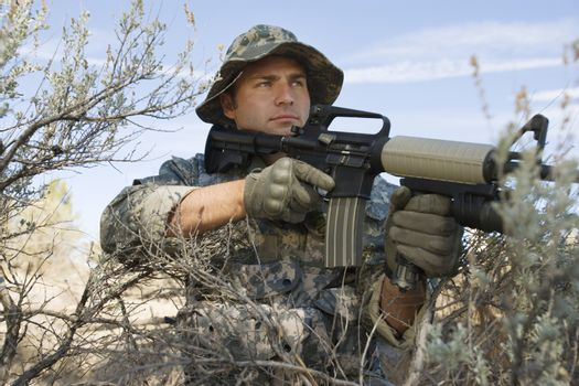 US army soldier ready to shoot with a machine gun