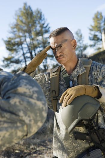 US army soldier saluting