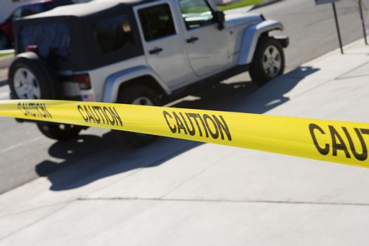 Jeep behind yellow caution tape at crime scene