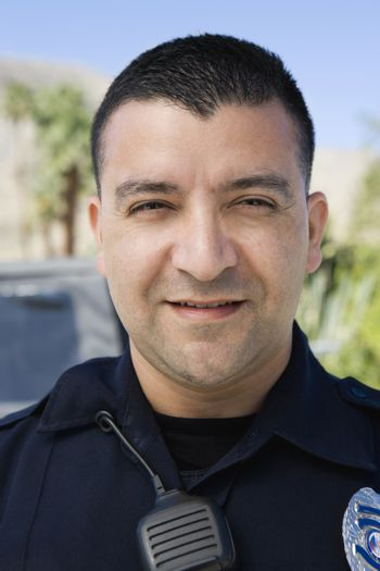 Portrait of a confident male police officer smiling
