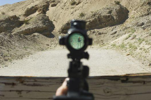 View of target through rifle scope at firing range