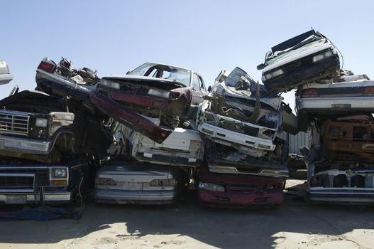 Stack of damaged cars in junkyard